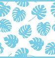 seamless pattern of blue monstera leaves tropical vector image