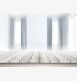 wooden table looking out to a defocussed room vector image vector image