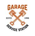 garage service station emblem with crossed vector image