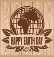 happy earth day lettering on a wooden background vector image vector image