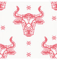 knitted seamless pattern with bull in red color vector image
