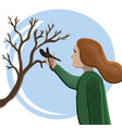 woman gardening pruning tree vector image