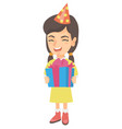 caucasian girl in birthday cap holding gift box vector image