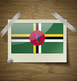Flags Dominica at frame on wooden texture vector image vector image