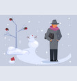 man walking through a snow covered park vector image