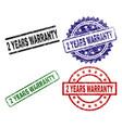 grunge textured 2 years warranty stamp seals vector image