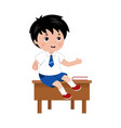 schoolboy sitting on the the desk in school class vector image vector image