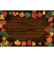 autumn leaves on the background wood vector image vector image