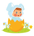 baby boy wearing easter bunny costume in egg vector image