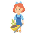 girl pushing wheelbarrow with soil and plant vector image