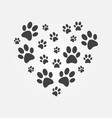 heart with icons of dog paw prints vector image