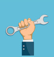 man holding industrial tool wrench in his hand vector image vector image