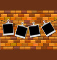 photo frames hanging on brick wall vector image vector image
