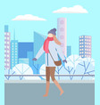 woman in warm clothes walking in winter city park vector image vector image