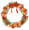 wreath with traditional symbols of new year and vector image