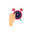 hand with alarm clock isolated icon vector image