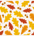 autumn seamless pattern with acorns and oak leaves vector image