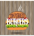 Classic burger with lettering on wooden board vector image vector image