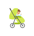 cute little boy sitting in a green bapram vector image vector image