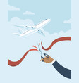 human hand cuts red ribbon to start flights vector image