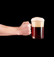 hand holding a glass of cold beer with full foam vector image