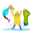 little kids playing on puddle vector image