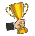 trophy cup prize in hand sketch engraving vector image