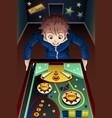 man playing pinball machine vector image