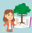 caucasian student pointing at tree of knowledge vector image vector image