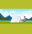 man hiker camper installing a tent preparing vector image vector image