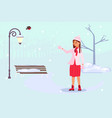 woman walking through a snow covered park vector image