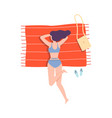 tattooed woman in swimming suit lying on beach vector image