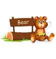 A bear holding a honey beside a wooden signboard vector image vector image