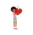 pretty african american teen girl holding red vector image vector image