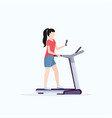 woman running on treadmill girl using smartphone vector image