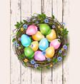 Easter nest wooden background