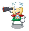 sailor with binocular cartoon baby sitting in the vector image vector image