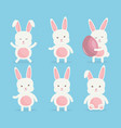 cute rabbits with easter eggs painted vector image vector image
