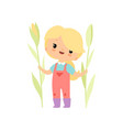 cute young girl in overalls and rubber boots with vector image vector image