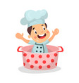 cute cartoon little boy chef character sitting in vector image vector image