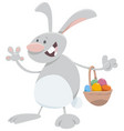 cartoon easter bunny with basket eggs vector image vector image
