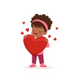 lovely little african american girl holding red vector image vector image