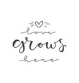lettering with phrase love grows here vector image vector image