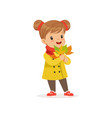 sweet little girl in warm clothing holding autumn vector image vector image