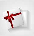 white gift box with red bow and ribbon top view vector image vector image