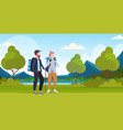 couple tourists hikers with backpacks and stick vector image vector image