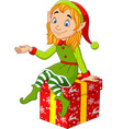 cartoon christmas elf sitting on gift vector image vector image