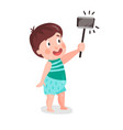 cute cartoon little boy making selfie with a stick vector image vector image