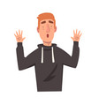 surprised young man with raised up hands male vector image vector image