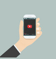 hand holding smartphone with video player vector image vector image